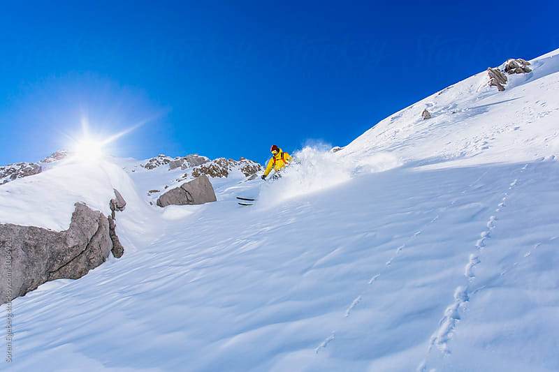 Powder skiing in the mountains of Austria by Soren Egeberg for Stocksy United