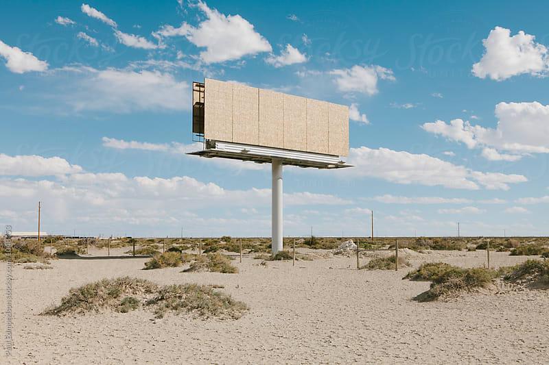 Empty billboard in desert, by Paul Edmondson for Stocksy United
