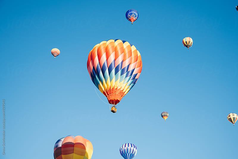 Multicolor hot air balloons  by Drew Schrimsher for Stocksy United