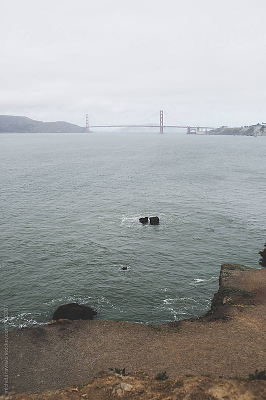 Seascape with Golden Gate bridge in the background by michela ravasio for Stocksy United