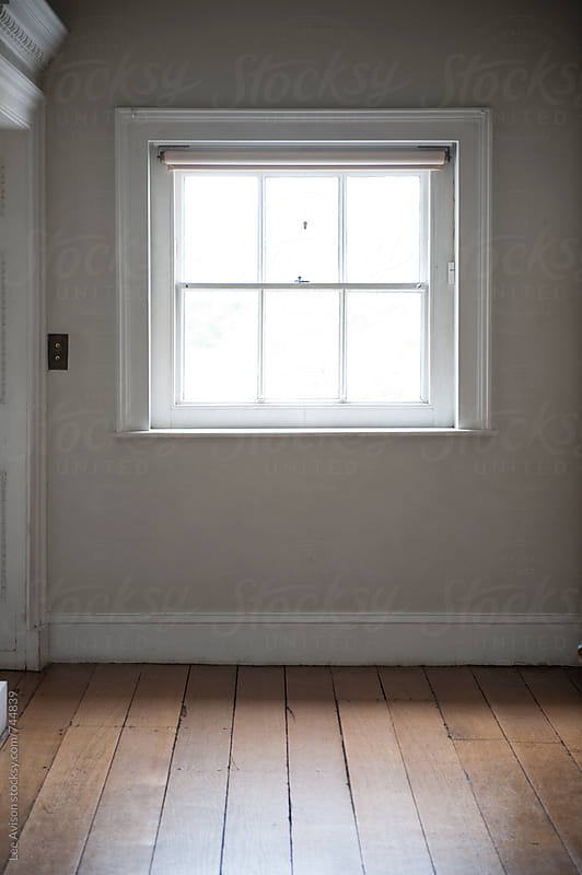 square window empty room interior wooden floorboards and grey wall by Lee Avison for Stocksy United