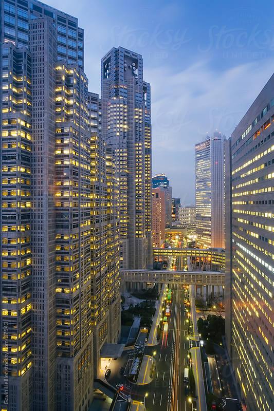 Asia, Japan, Honshu, Tokyo, Shinjuku, Shinjuku office buildings and street illuminated at dusk - elevated view by Gavin Hellier for Stocksy United
