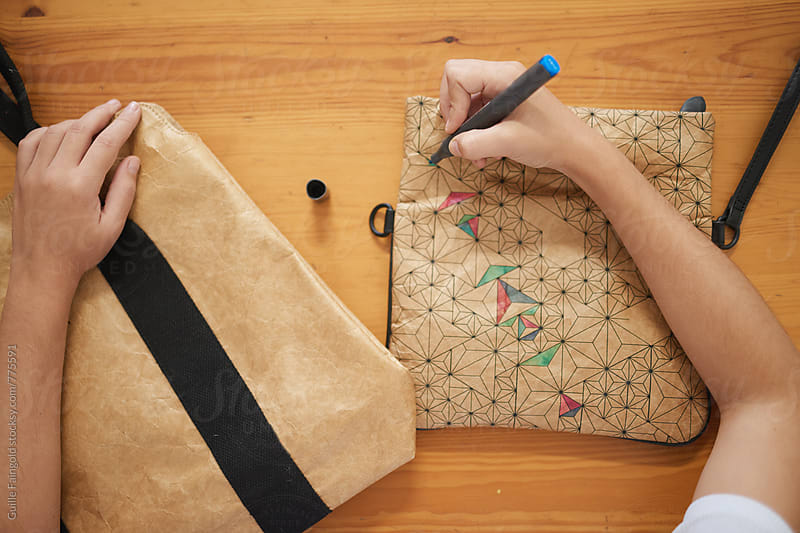 a young woman creating a handmade bag by Guille Faingold for Stocksy United