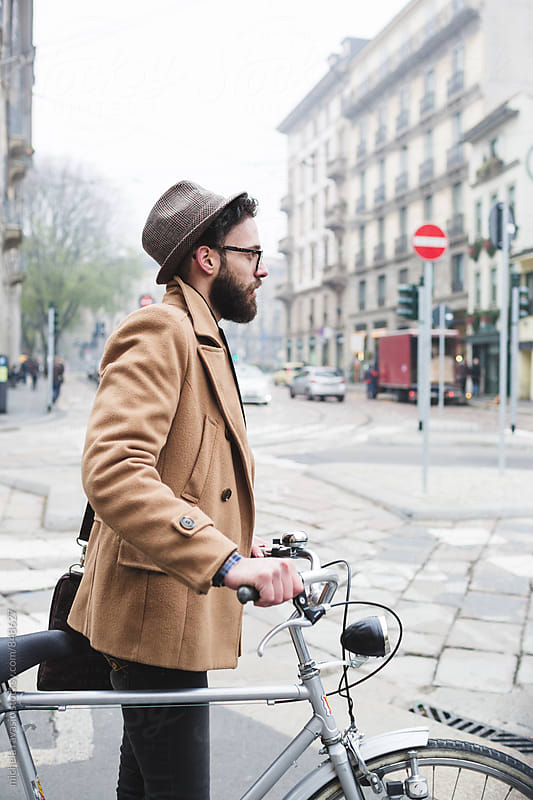 Young hipster with bicycle around the city by michela ravasio for Stocksy United