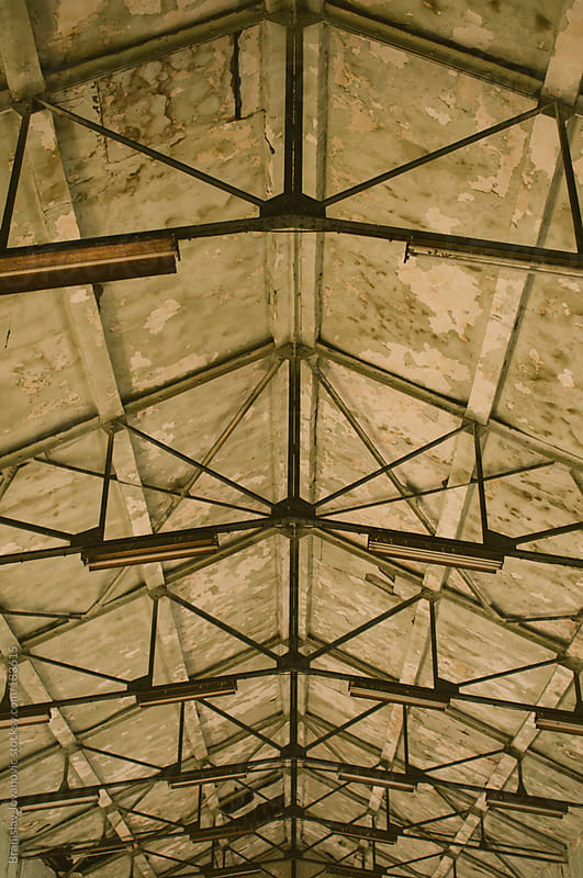 Construction on the ceiling in an abandoned factory by Brkati Krokodil for Stocksy United