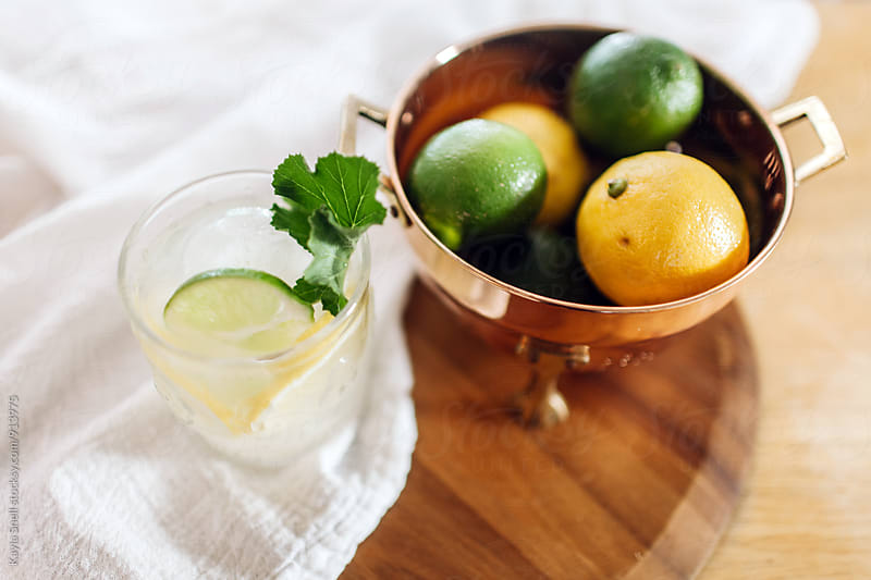 Lemon & Lime Cocktail by Kayla Snell for Stocksy United