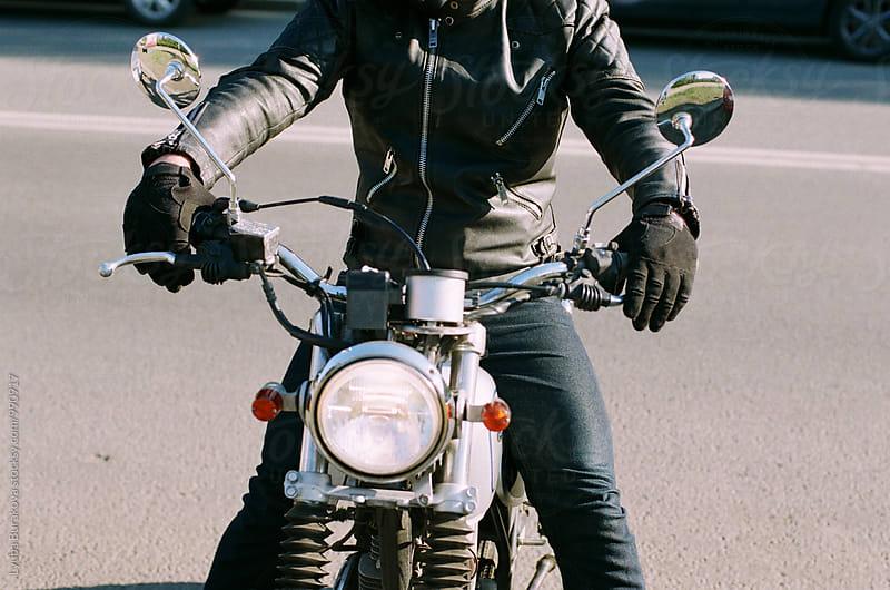 Man on motor bike. Close up shot by Lyuba Burakova for Stocksy United
