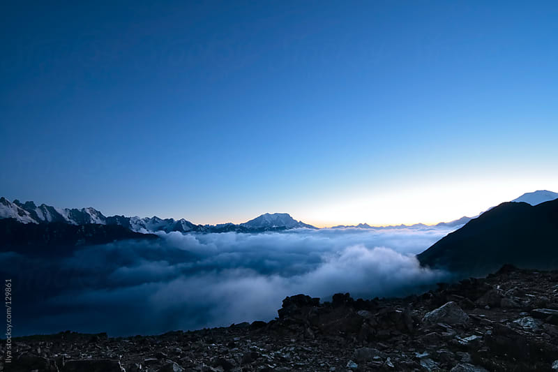 Caucasus mountains in the evening by Ilya for Stocksy United