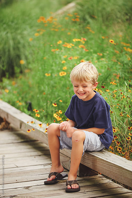 portrait of a laughing boy by Kelly Knox for Stocksy United