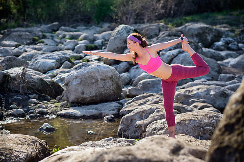 Beautiful sporty and fit woman practicing yoga outdoor in a park by Suprijono Suharjoto for Stocksy United