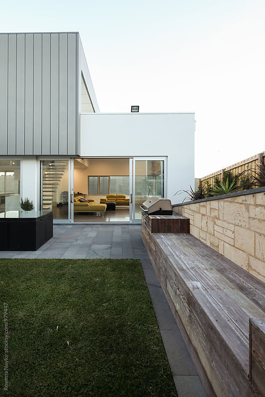 Outdoor area of architect designed home by Rowena Naylor for Stocksy United