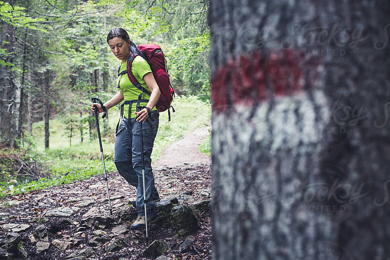 Female hiker on mountain by Mauro Grigollo for Stocksy United