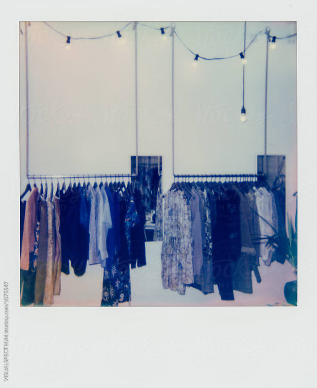 Polaroid of Clothing Racks in Retail Clothing Store by VISUALSPECTRUM for Stocksy United