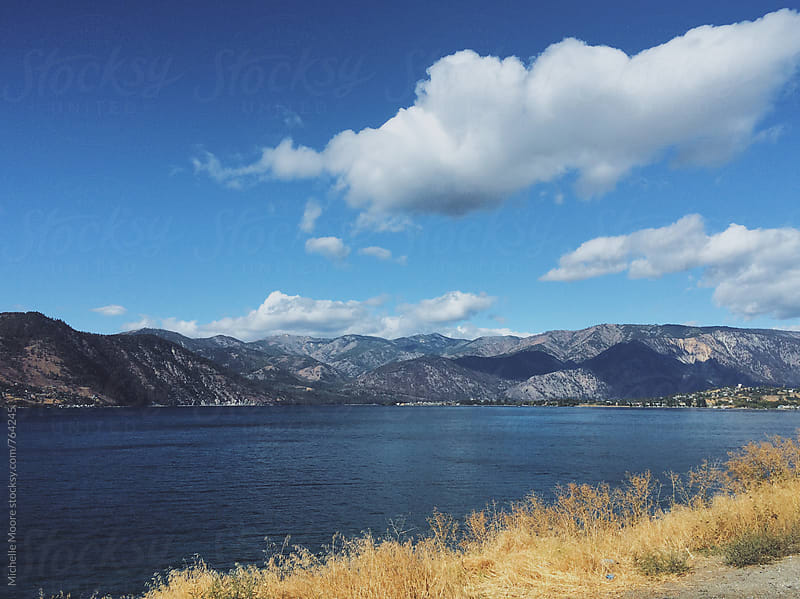 Lake Chelan with Blue Sky and Clouds by Michelle Moore for Stocksy United