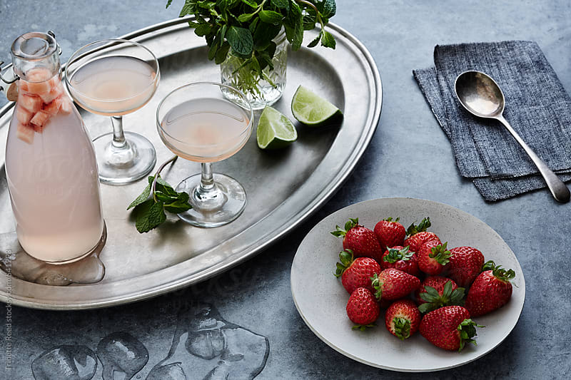 Strawberry, lime, and mint cocktail by Trinette Reed for Stocksy United