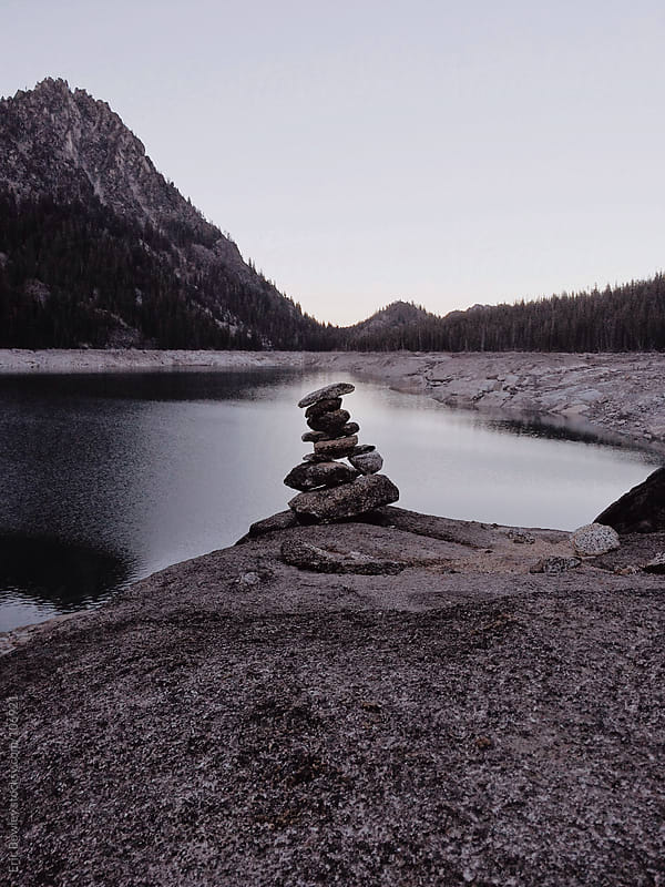 Snow Lake Rock Cairn by Eric Bowley for Stocksy United