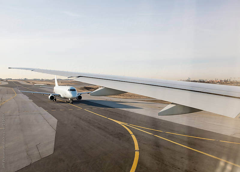 Wing View of Aircraft on Runway by Studio Six for Stocksy United
