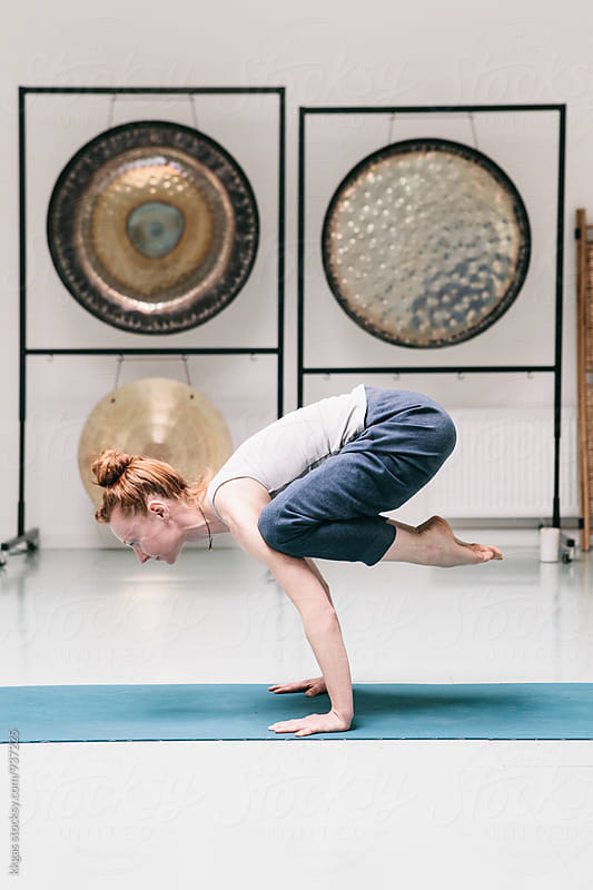 Woman practicing yoga  by kkgas for Stocksy United