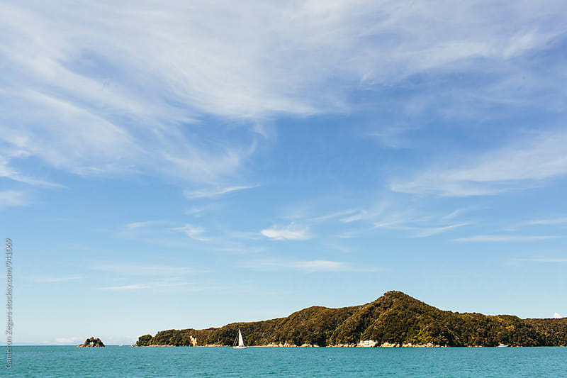 Sailboat in Abel Tasman National Park, New Zealand by Cameron Zegers for Stocksy United