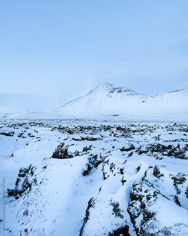 A snow covered field of lava rocks by Jonatan Hedberg for Stocksy United