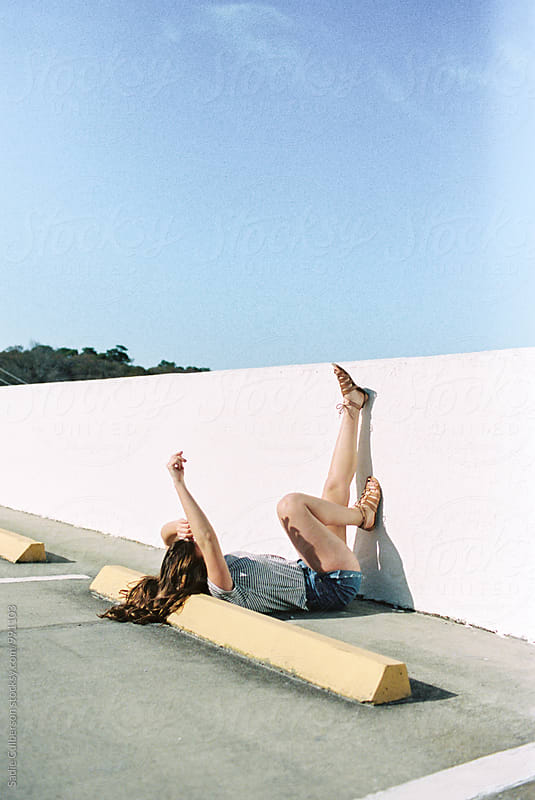Girl Plays On Parking Deck by Sadie Culberson for Stocksy United