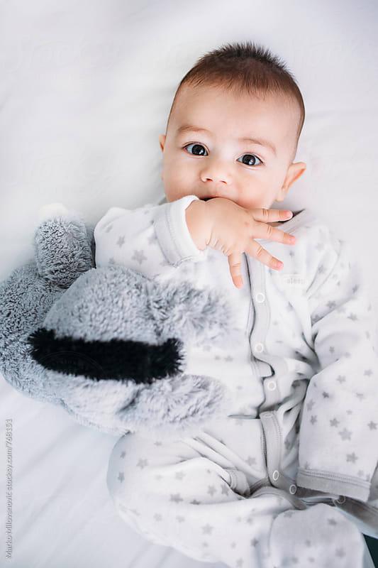 Baby at home by Marko Milovanović for Stocksy United