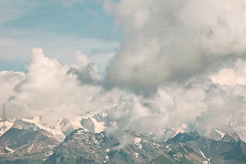 Alpine Alps cloudy mountains landscape, France. by BONNINSTUDIO for Stocksy United