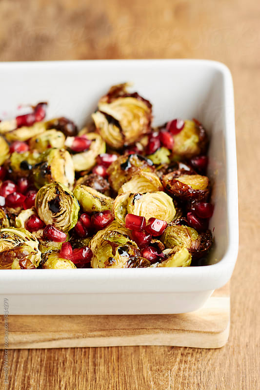 Roasted Brussels sprouts with pomegranate arils by Harald Walker for Stocksy United