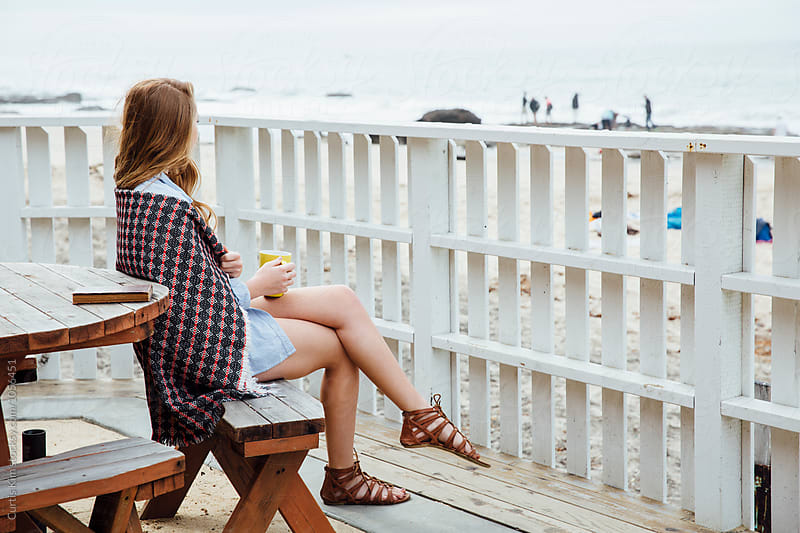 Early morning coffee overlooking the beach and ocean by Curtis Kim for Stocksy United