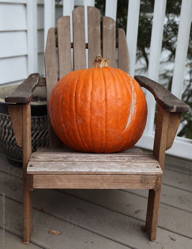 Orange Halloween Pumpkin In A Chair by Carey Haider for Stocksy United