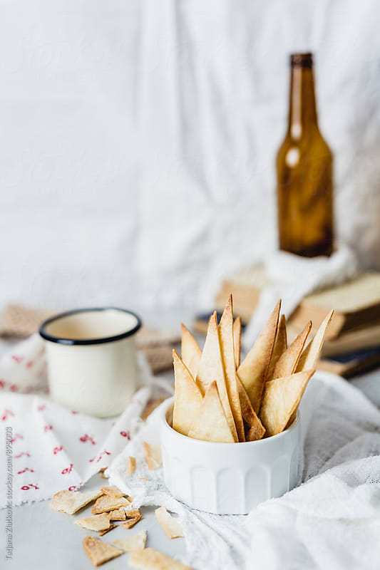 Homemade nacho chips by Tatjana Ristanic for Stocksy United