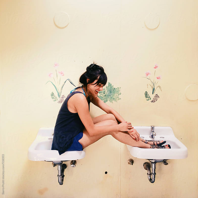 girl in sink by Sierra Pruitt for Stocksy United