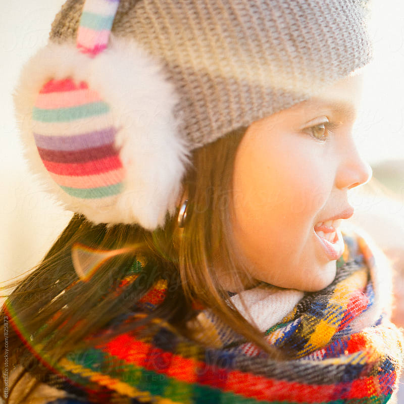 girl with winter ear muffs by otto schulze for Stocksy United