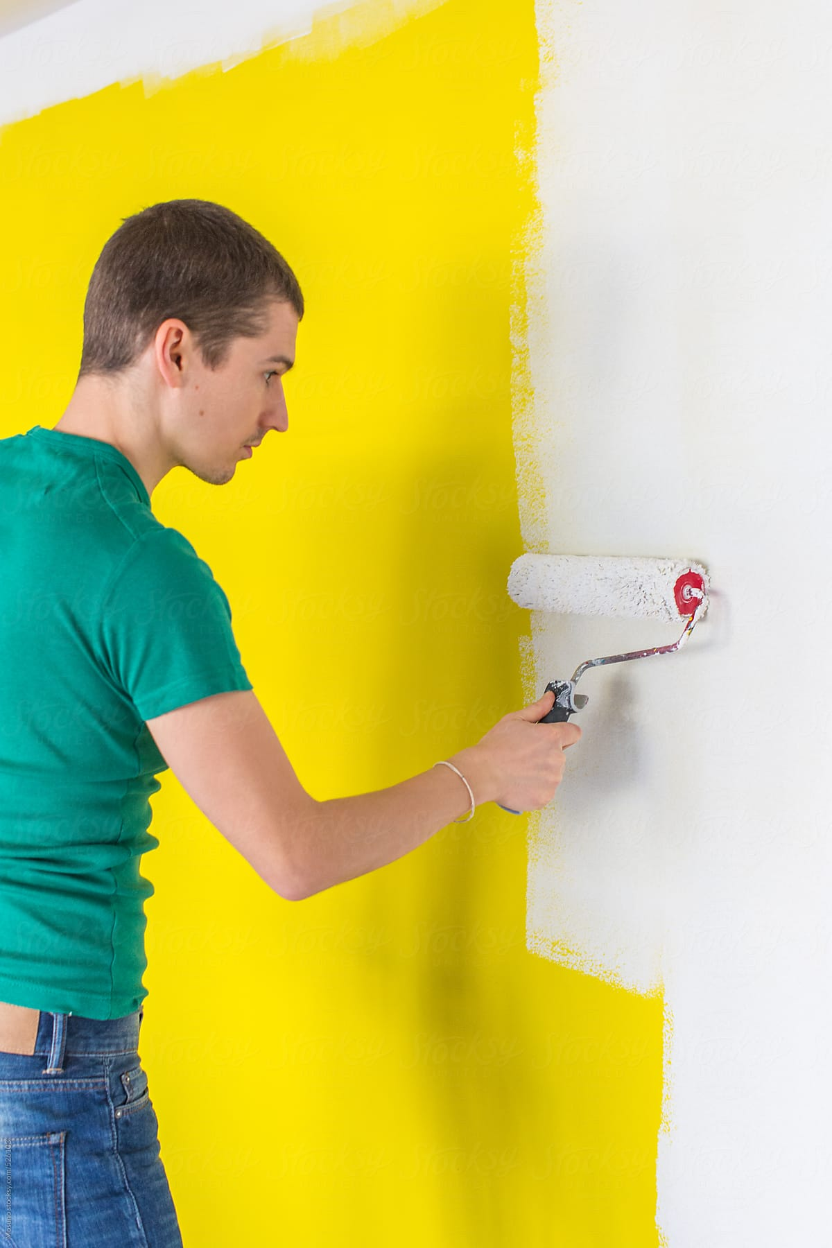 Man Painting Yellow Wall in His House by Mosuno - Stocksy United