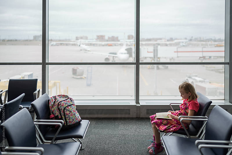 Little Girl Waiting For Flight at Modern Airport Traveller Lounge by JP Danko for Stocksy United
