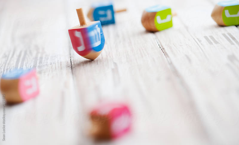 Holidays: Spinning Dreidel On Wooden Table by Sean Locke for Stocksy United