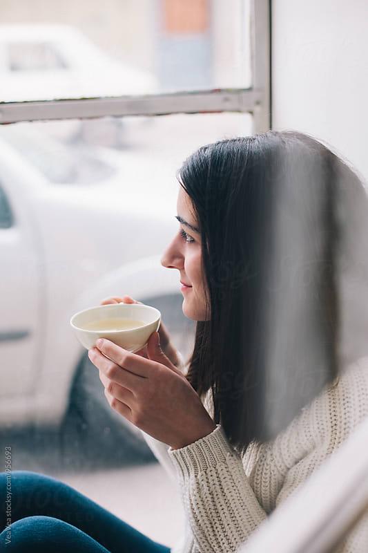 Brunette woman drinking tea by VeaVea for Stocksy United