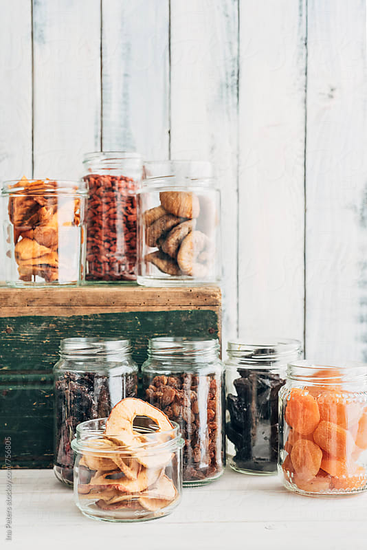 Food: Different dehydrated berries in jars by Ina Peters for Stocksy United