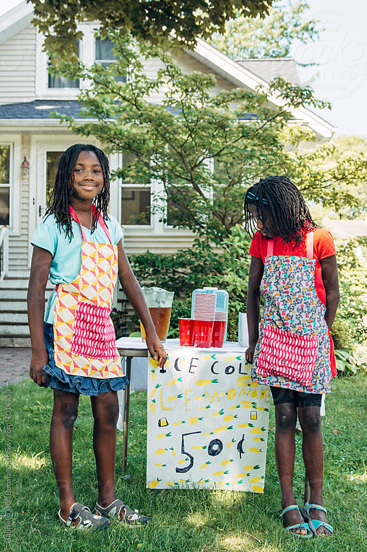 Two black girls by a lemonade stand by Gabriel (Gabi) Bucataru for Stocksy United