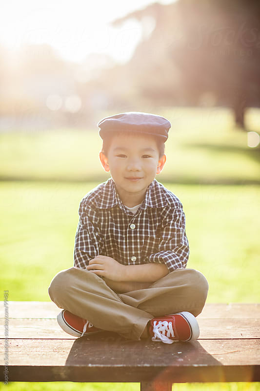 Asian kid portrait outdoor by Suprijono Suharjoto for Stocksy United