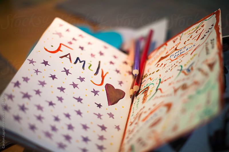 Journal open to a page decorated with Family in mind by Carolyn Lagattuta for Stocksy United