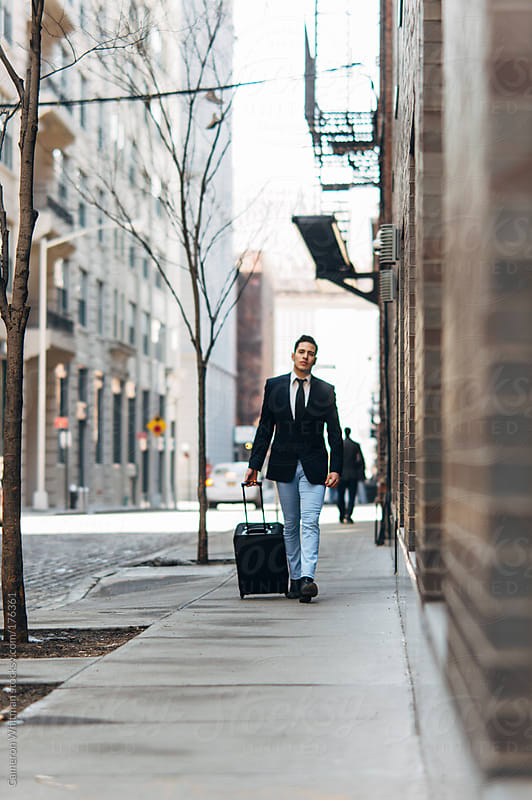 Stylish Mexican Businessman With Suitcase In the City by Cameron Whitman for Stocksy United