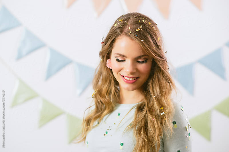 Portrait of a Beautiful Young Woman with Confetti in her Hair by Aleksandra Jankovic for Stocksy United