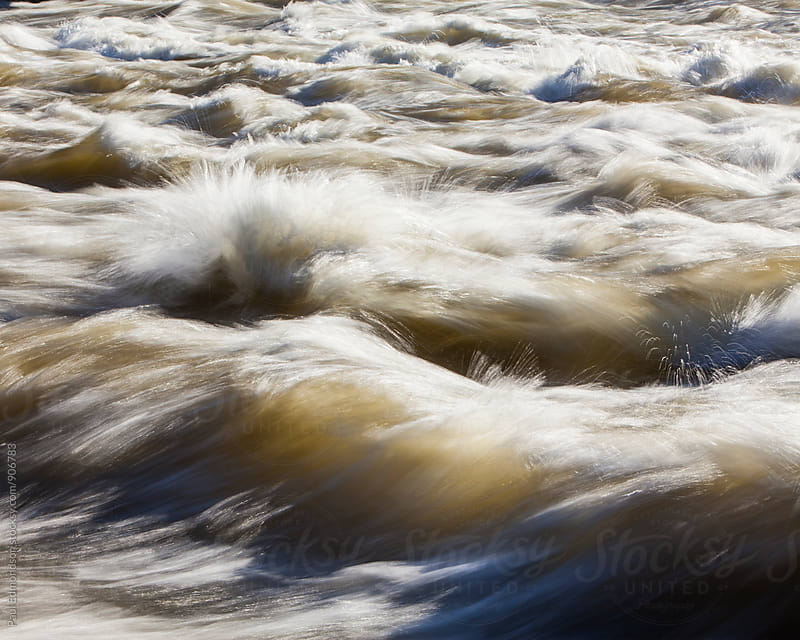 Fast moving river water, long exposure by Paul Edmondson for Stocksy United