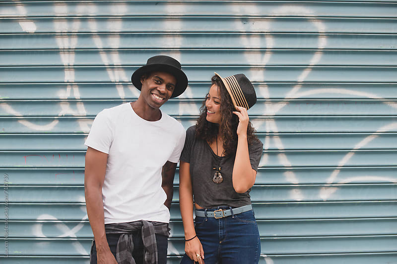 Happy young couple hanging out in the city by Lauren Naefe for Stocksy United