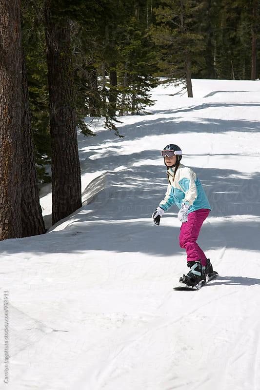 Teenage girl snowboarding in the Sierras by Carolyn Lagattuta for Stocksy United