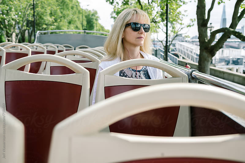 Woman on Double Decker Tour by Jeff Wasserman for Stocksy United