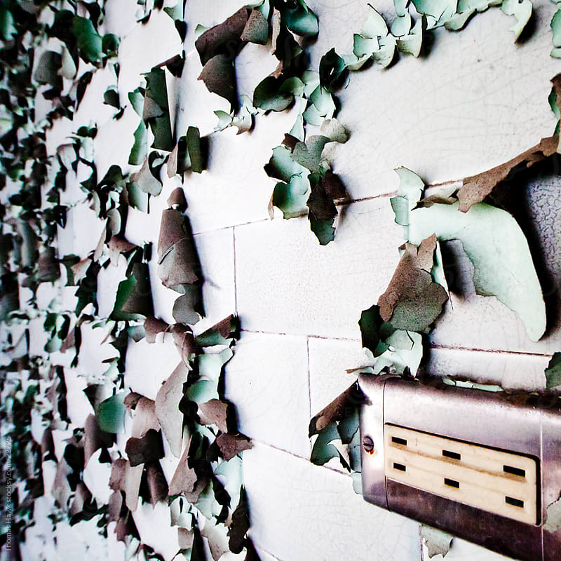 Peeling Paint and plug by Thomas Hawk for Stocksy United