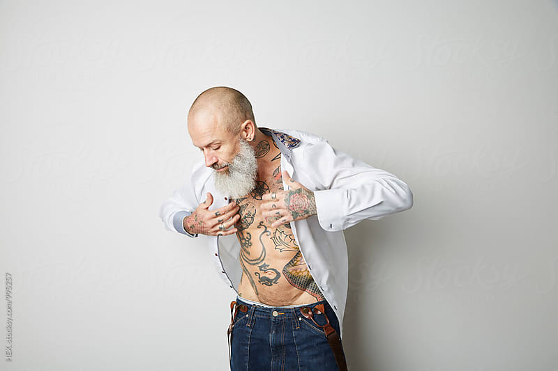 Man With Tatoo Studio Portraits  by HEX. for Stocksy United