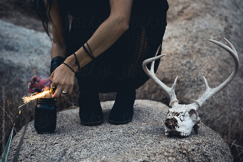 Witchy Woman's Feet with Sparks and Deer Skull  by MEGHAN PINSONNEAULT for Stocksy United